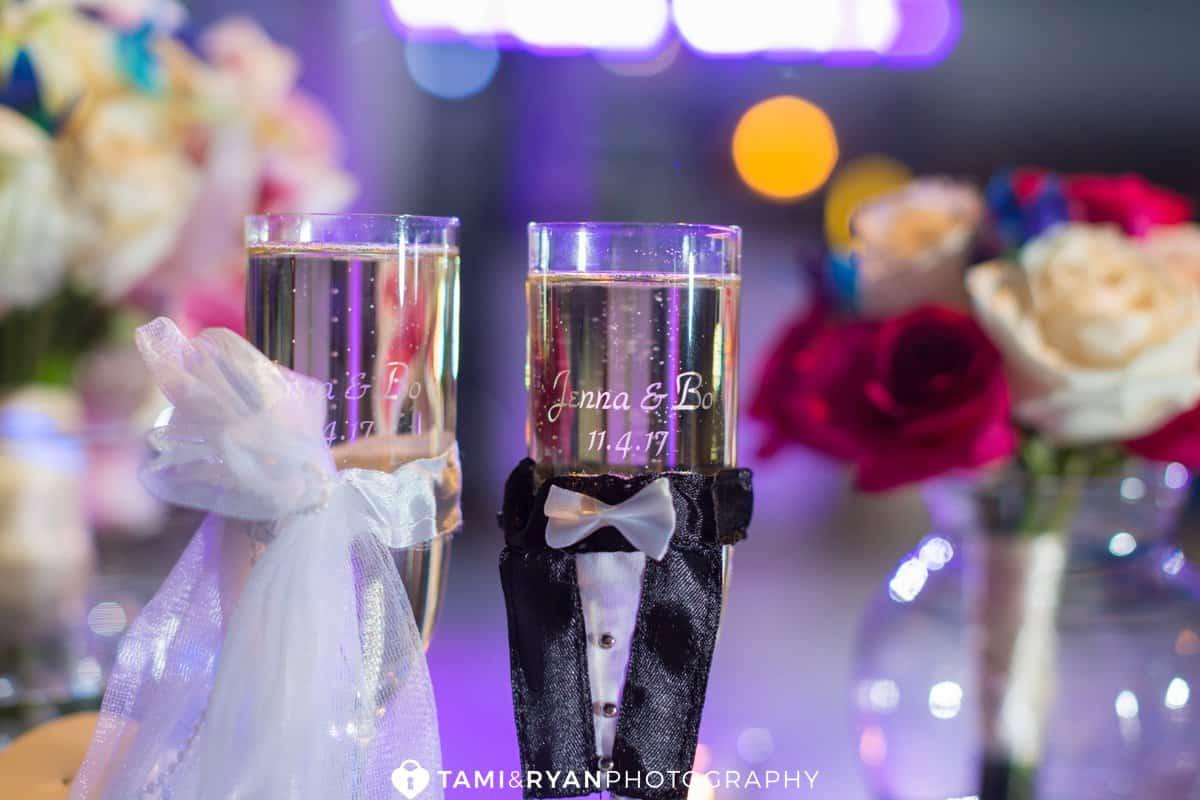 bride groom tasting champagne flutes