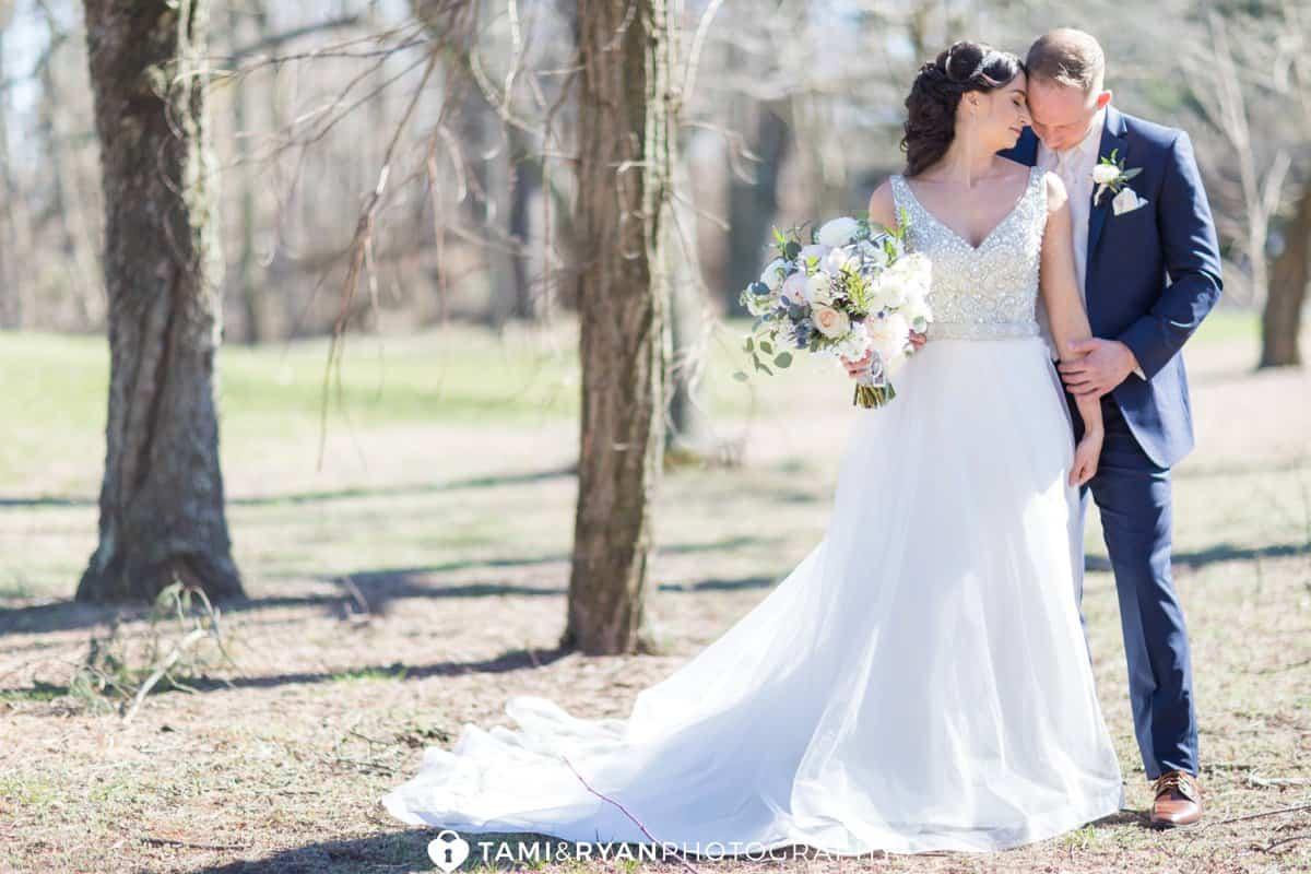 bride groom kiss shoulder golf course