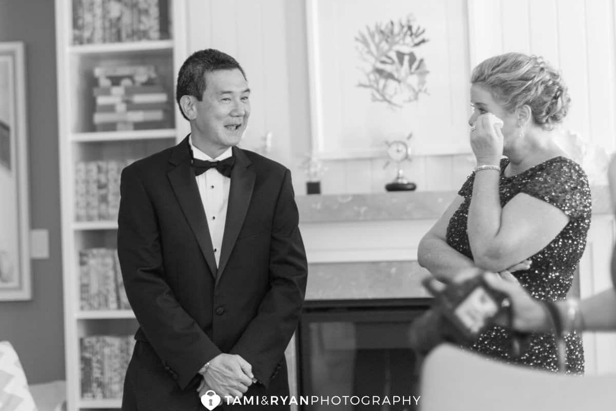 bride mom wiping away tear