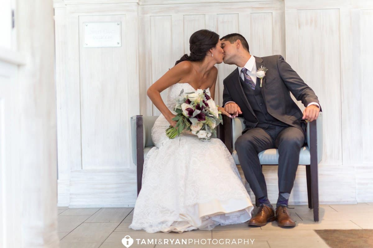 bride groom sitting kissing