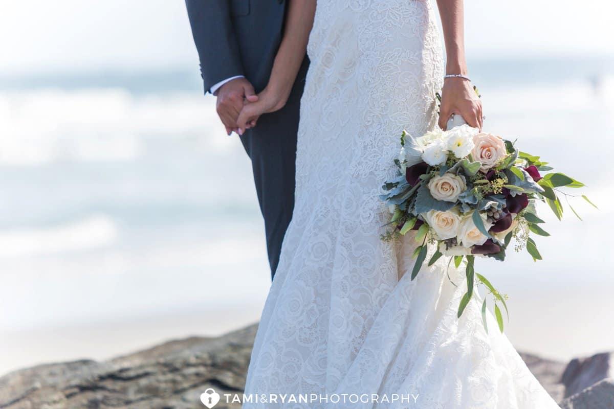 bride groom holding hands bouquet