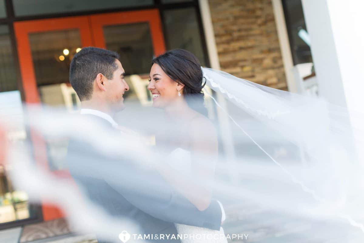 bride groom smile veil wind