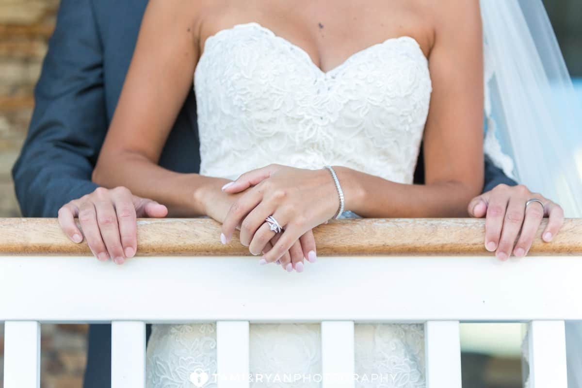 bride groom hands rings