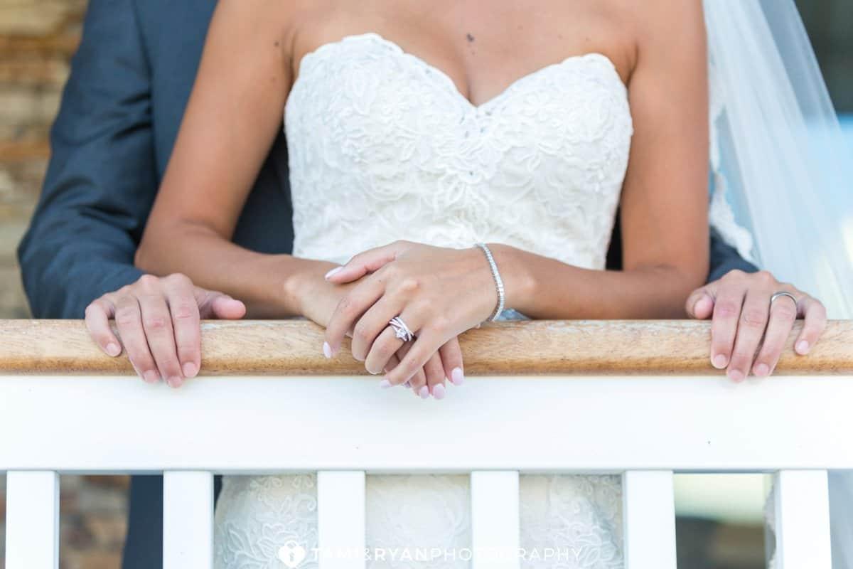bride groom hands rings