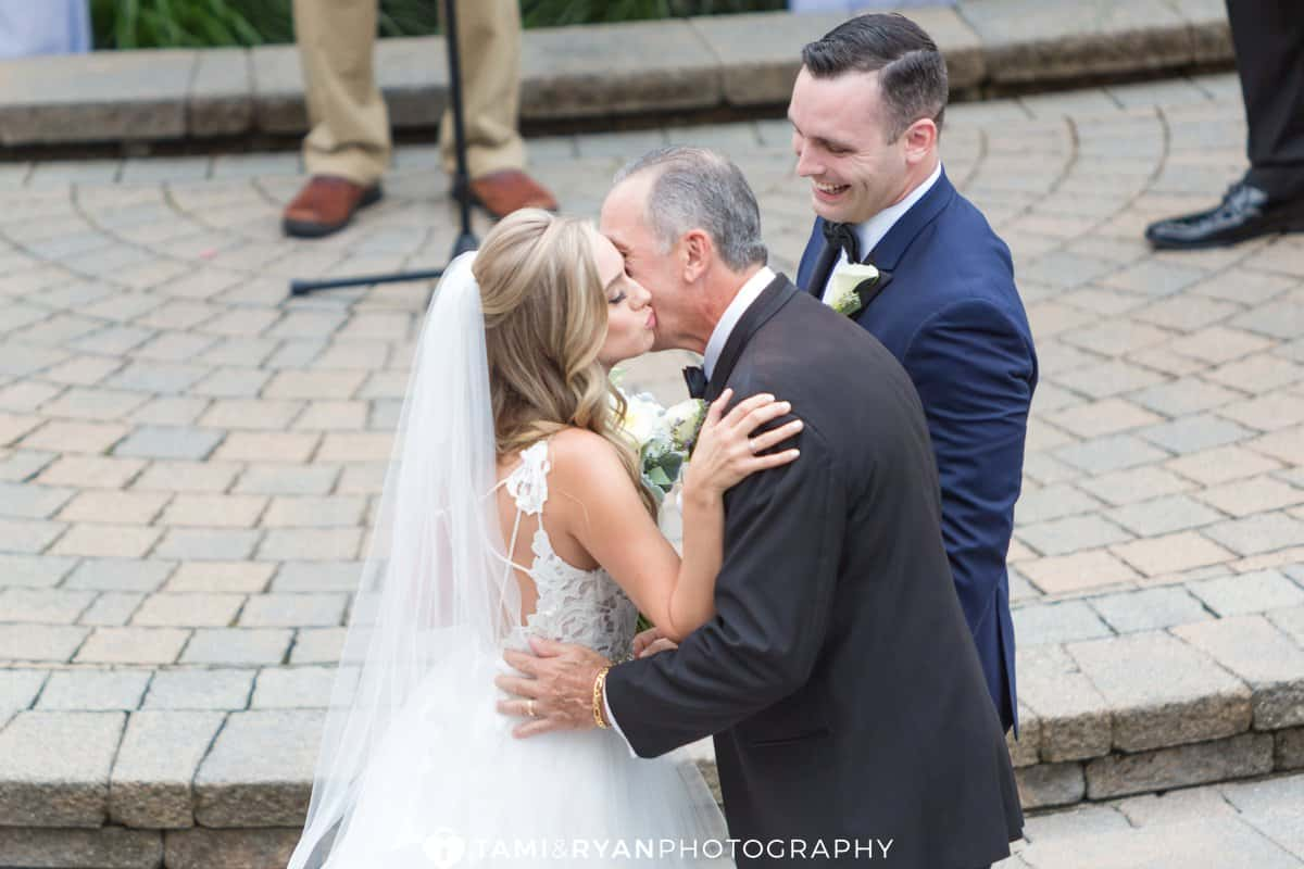 dad kiss bride ceremony