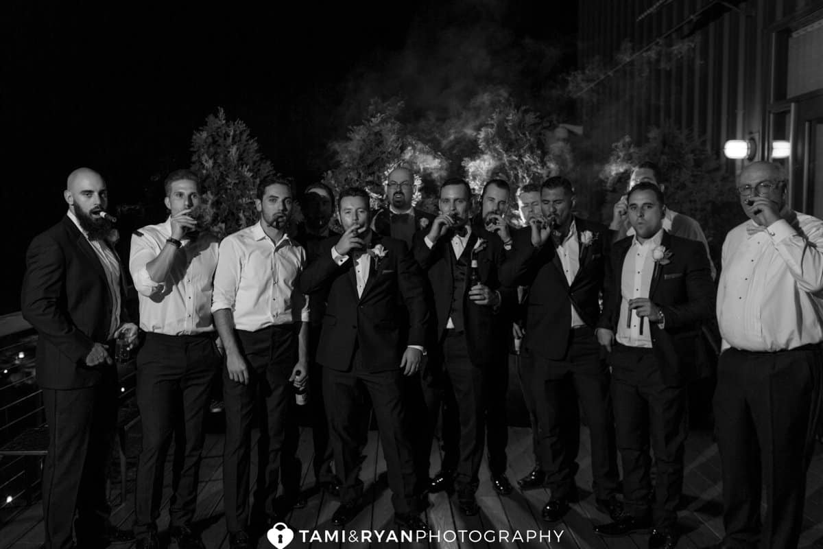 groom groomsmen smoking cigars