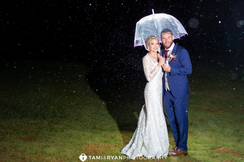 bride groom rain portrait