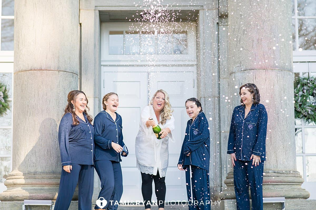 bride bridesmaids spray champagne